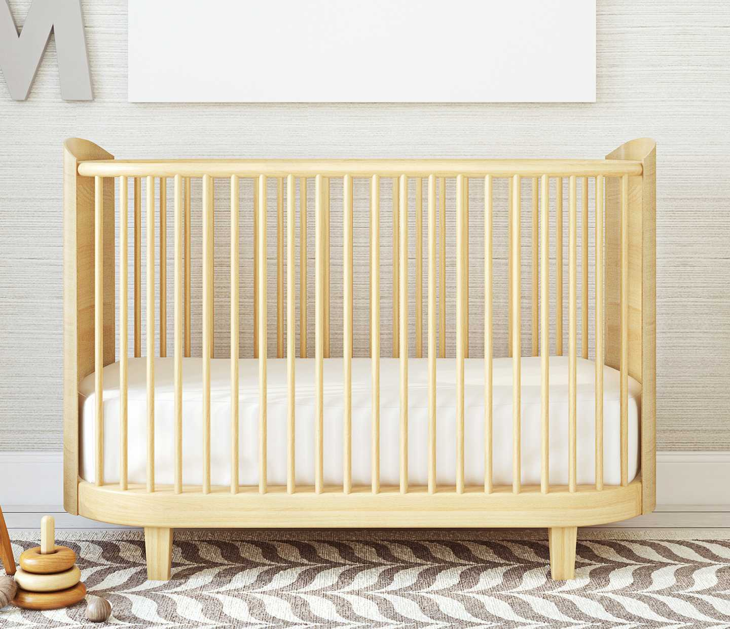 Wooden crib with patterned rug