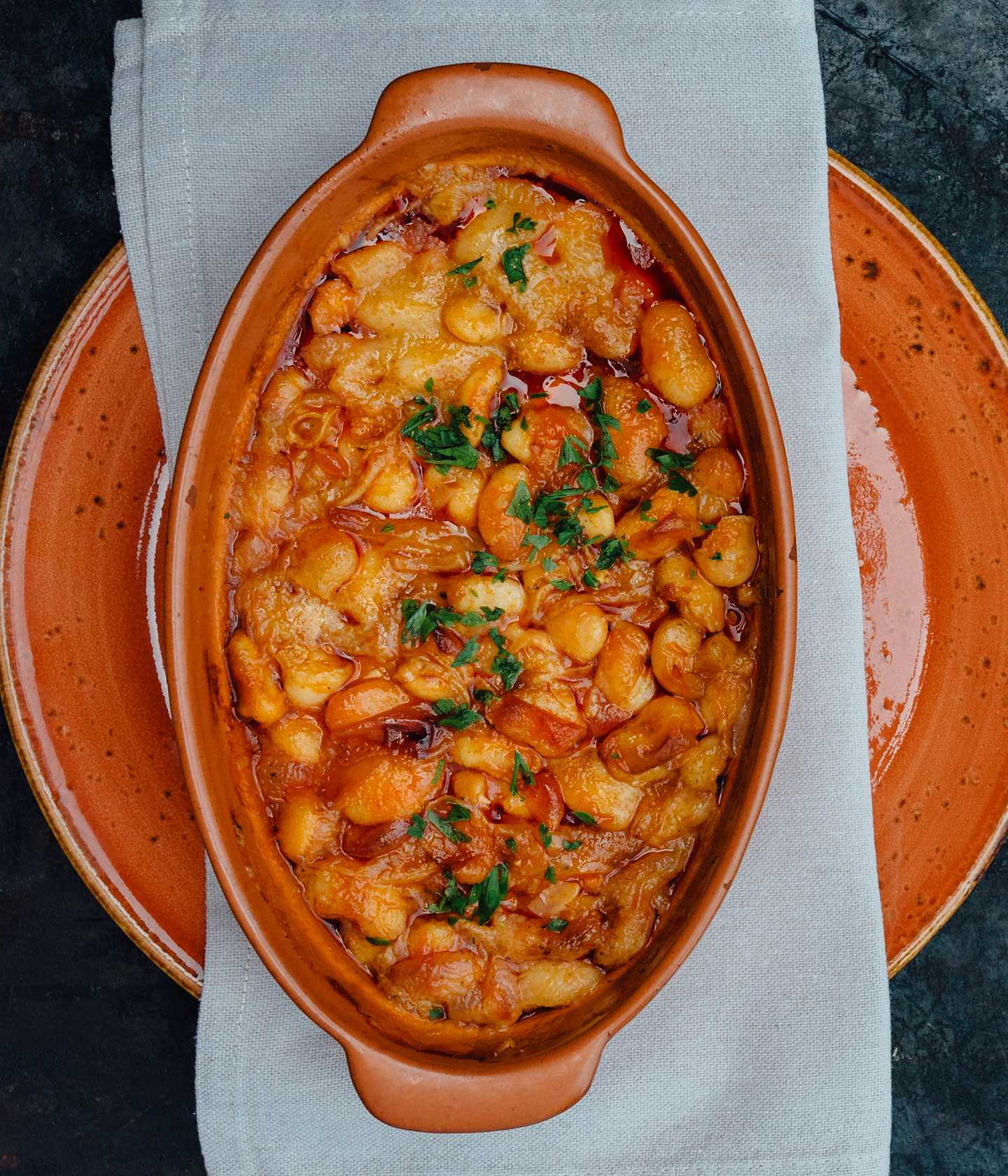Dish of baked beans in sauce