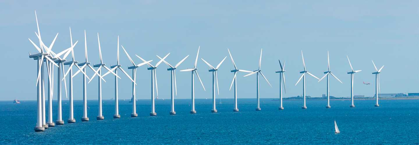 A group of wind turbines built in the water