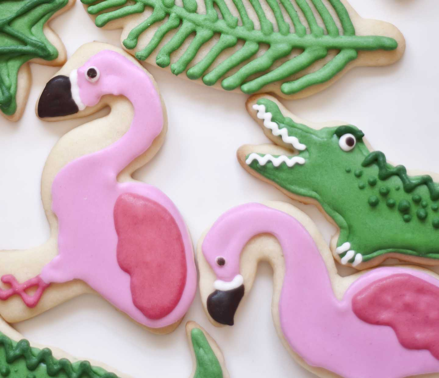 Flamingo and alligator iced cookies