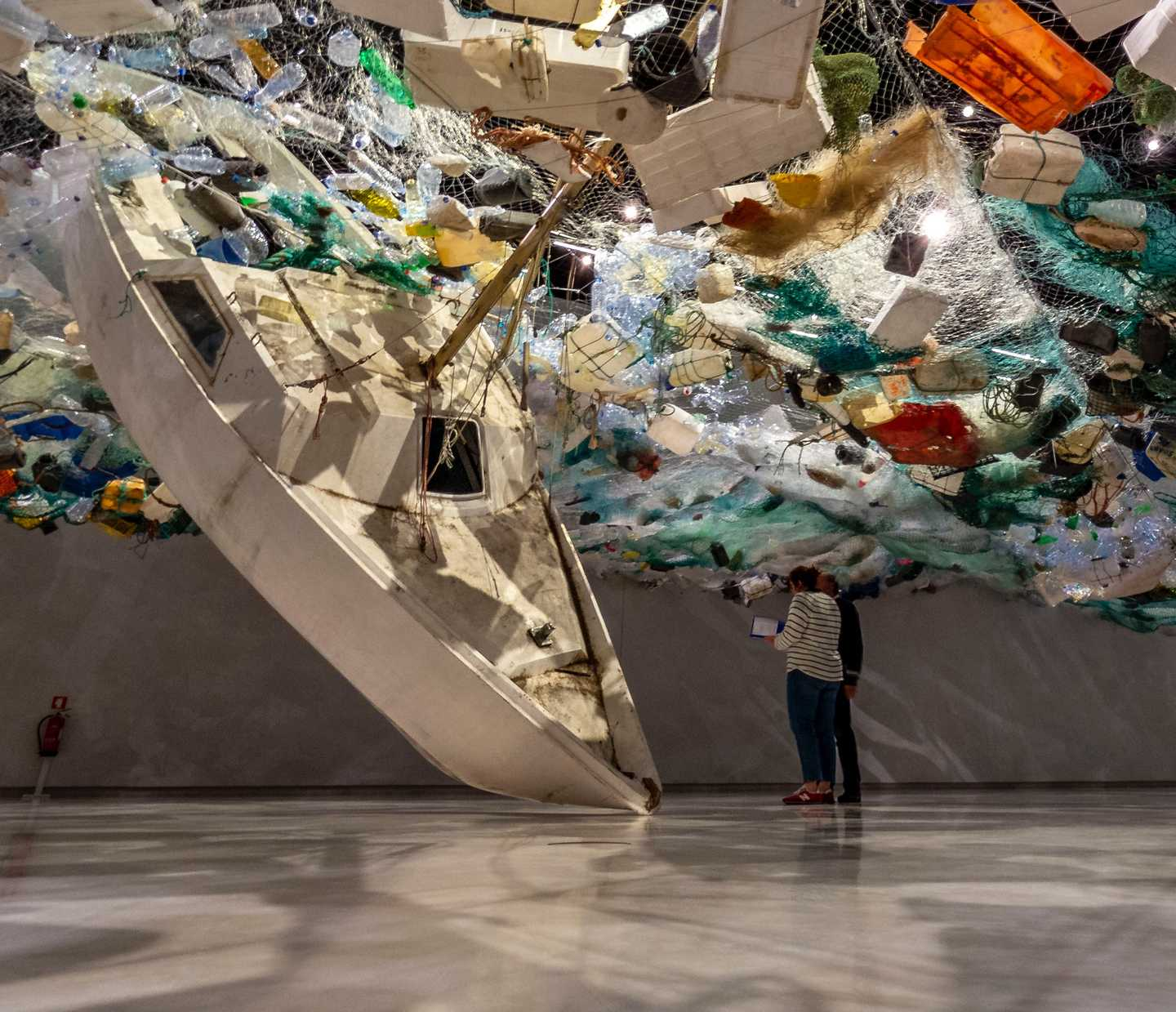 A boat and an art installation made using rubbish