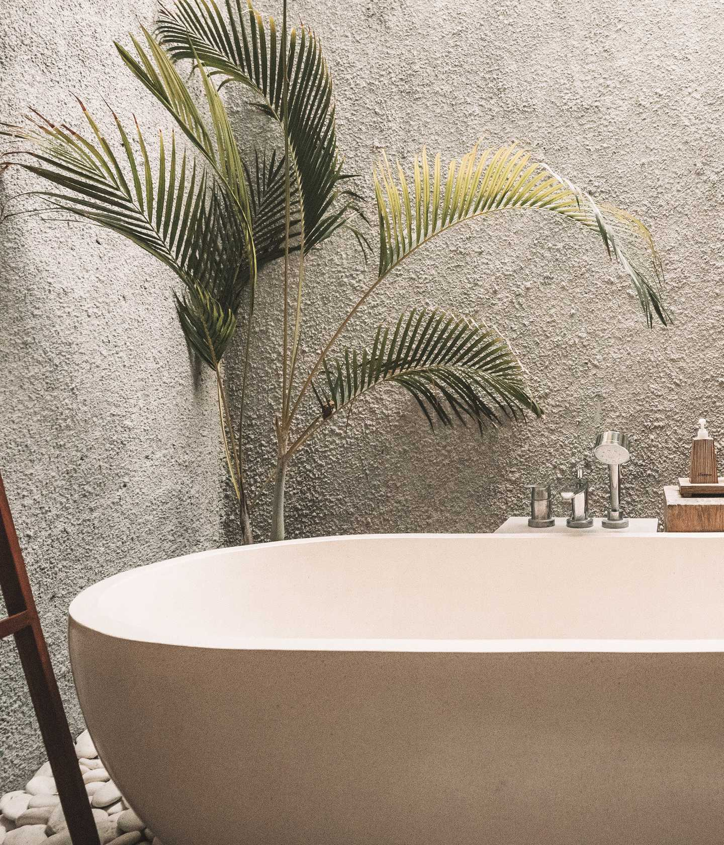 Deep ceramic soaking tub in a modern environment